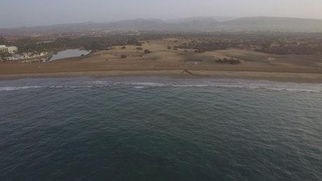 Drone flying slowly towards land