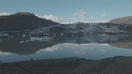 Drone flying towards a glacier