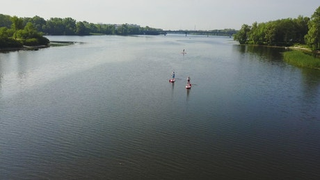 Drone view of paddle boarders on river
