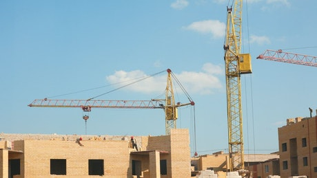 Drones and workers at the construction site