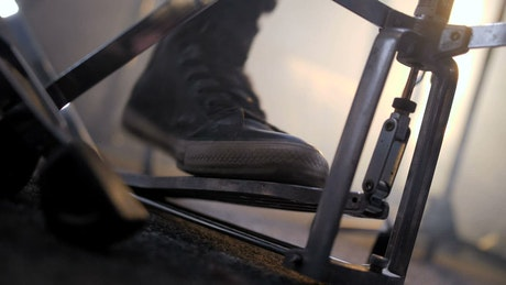 Drummer using a foot pedal