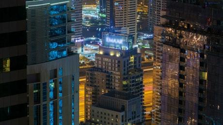 Dubai billboard and cityscape at night