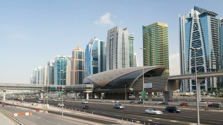 Dubai train station and highway with fast traffic
