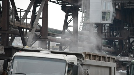Dust and smoke rising from a truck