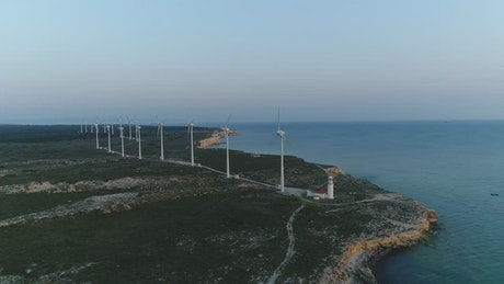 Early morning by a wind farm