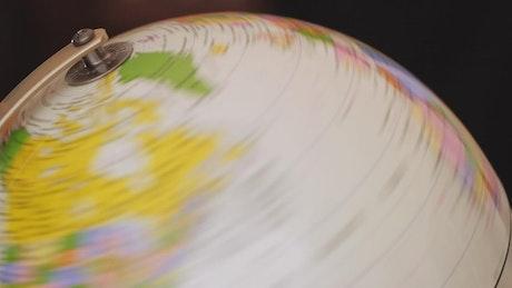 Earth globe rotating on a dark background