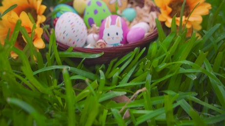 Easter eggs in a basket in the garden