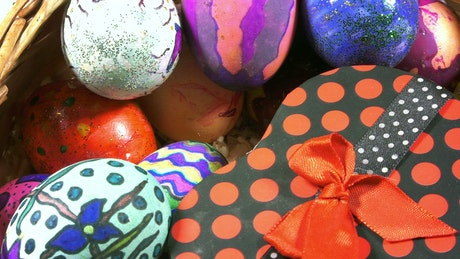 Easter gift surrounded by colorful eggs