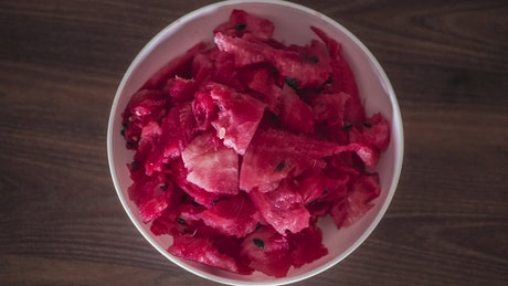 Eating a bowl of watermelon