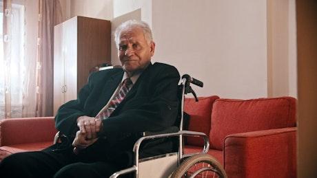 Elder on a wheelchair looking sad