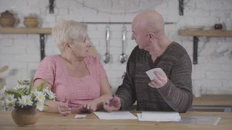 Elderly couple argue over bills