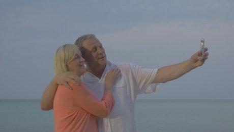 Elderly couple taking a photo on vacation
