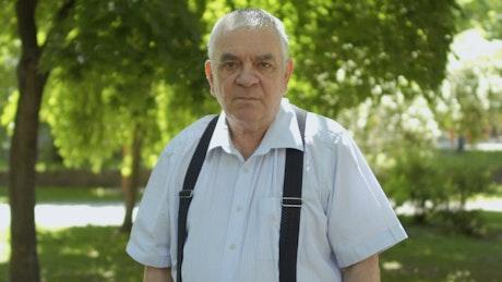 Elderly deaf man signs Hear us