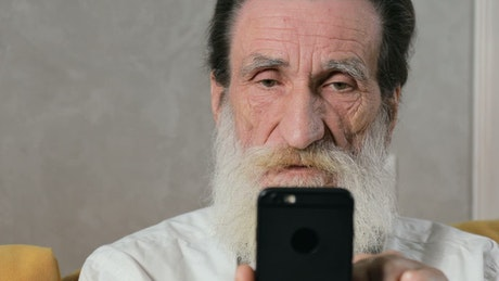 Elderly man confused by mobile app