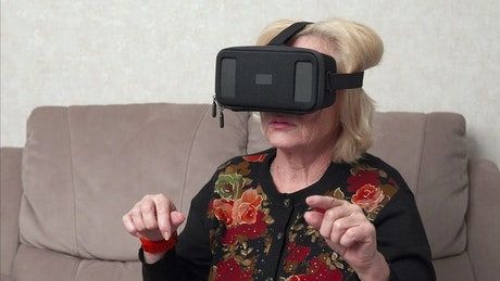 Elderly person using a VR headset