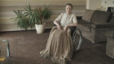 Elderly woman in wheelchair in nursing home