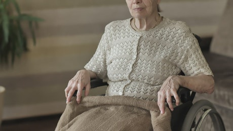 Elderly woman in wheelchair, portrait