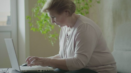 Elderly woman working from home