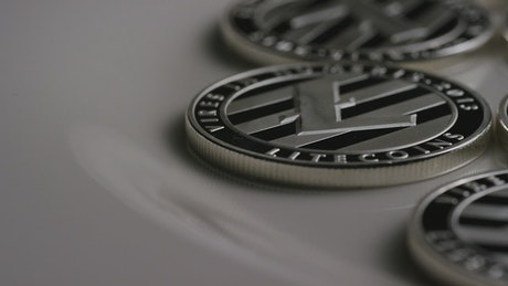 Elegant LItecoin coins slowly rotating