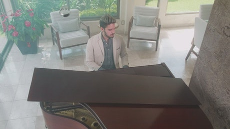 Elegant pianist playing at his home