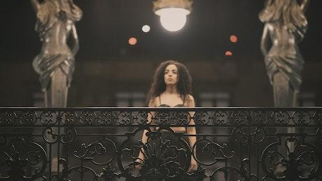 Elegant woman waiting in a kiosk
