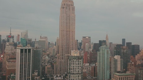 Empire State Building surrounded by other buildings