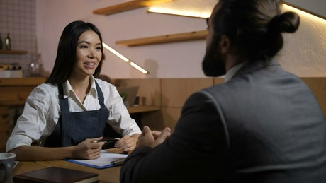 Employer interviewing a potential candidate