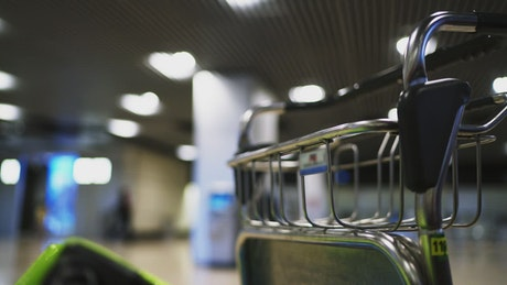 Empty airport luggage cart close up