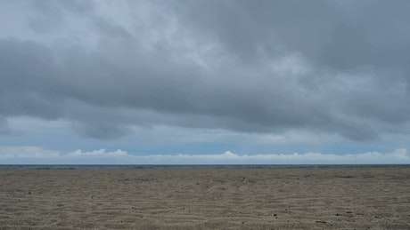 Empty beach with cloudy sky