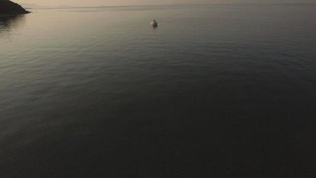 Empty boat anchored off the coast