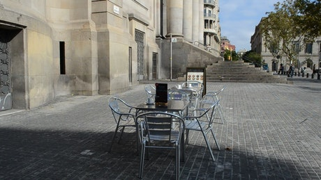 Empty glass tables in Barcelona