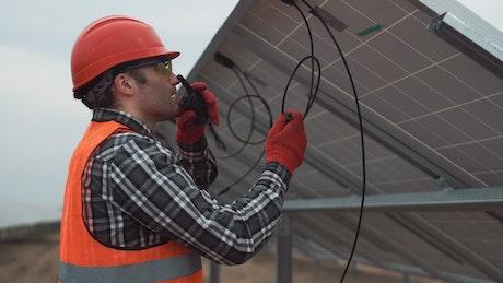 Engineer installing solar panels