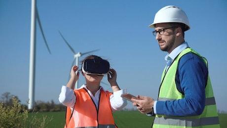 Engineer using virtual reality headset outdoors