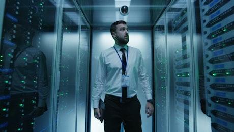 Engineer walking in data center hallway