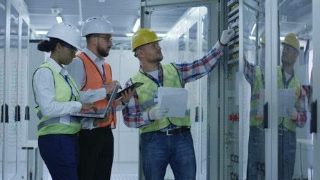Engineers checking equipment data