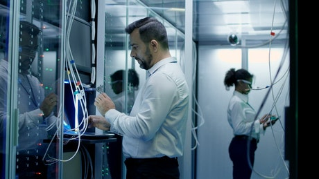 Engineers setting up a data center