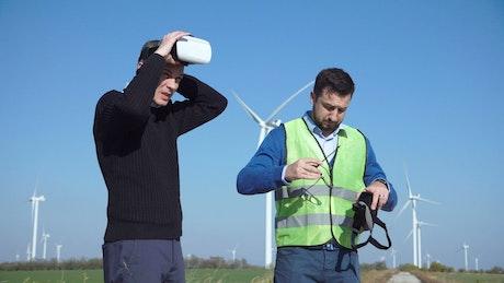 Engineers using VR headsets on wind farm