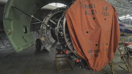 Engineers working on a jet engine