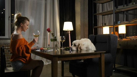 Enjoying a glass of wine with her dog