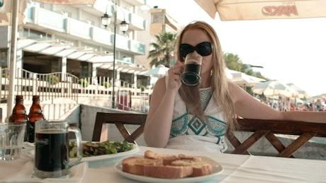 Enjoying lunch at a seaside cafe
