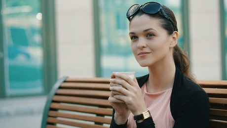 Enterprising woman drinking coffee before work