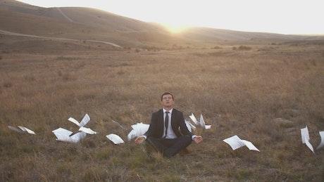Entrepreneur business man meditating in nature