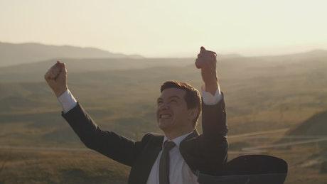 Entrepreneur who wears a suit celebrating