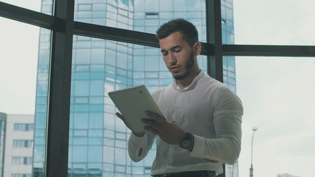 Entrepreneur working on a tablet in his office