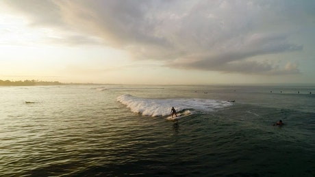 Epic aerial shot of a female surfer on the waves