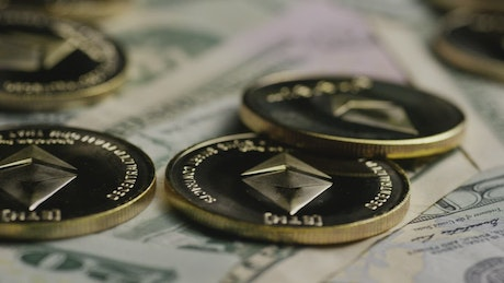 Ethereum golden coins over dollar bills
