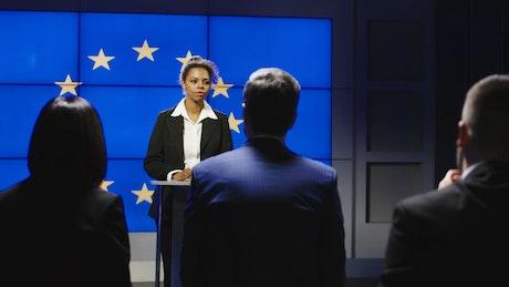 European politician talking in front of reporters