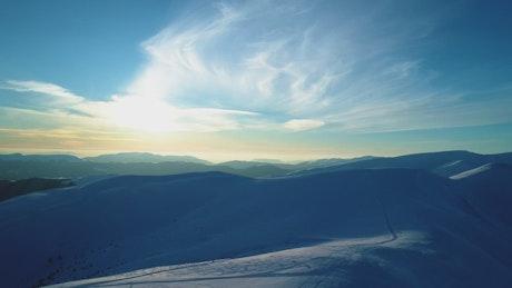 Evening sun illuminating snowy mountains