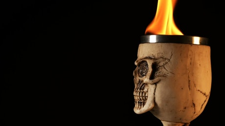 Evil skull shaped bone cup with fire