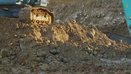 Excavator digging in the ground